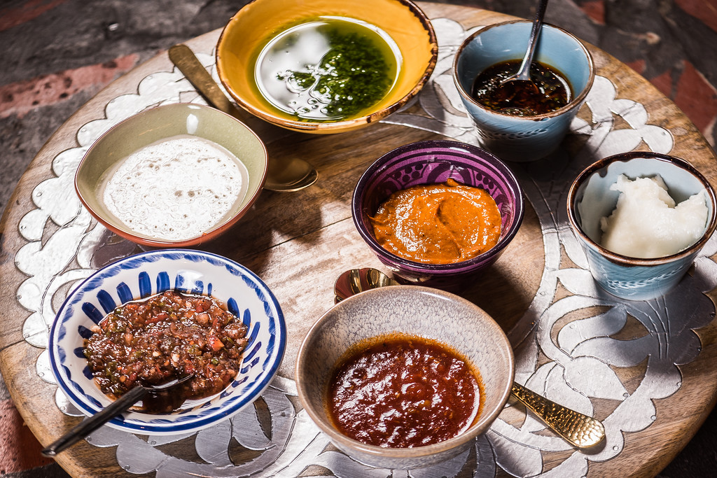 And don't sleep on the condiments, which at $1 each are a no-brainer! They range from harissa to zhough, tomato jam, tahina and ezme. (Image: Rey Lopez)